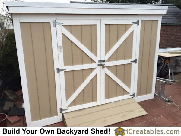 Completed 4x8 Short Lean to backyard storage shed with overall height of less than 8 feet.