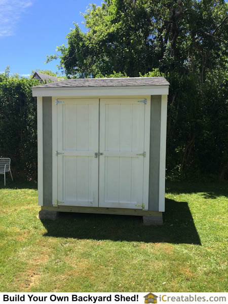 Shed doors built and installed with door hardware.