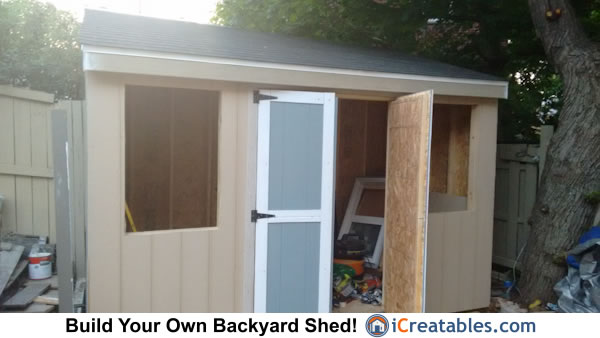 6x12 Lean to shed siding installed and start painting.