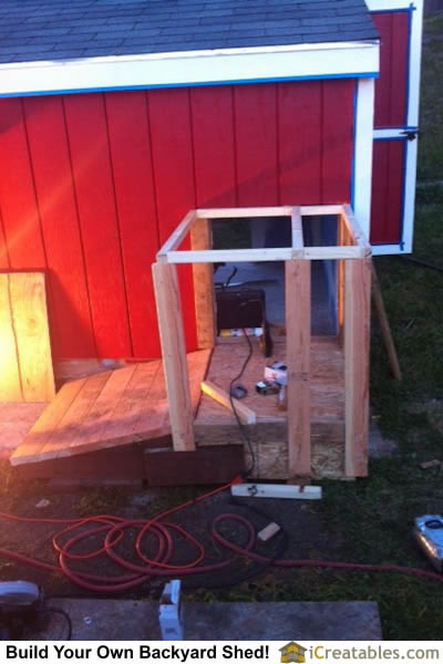 Wall framing for doggie door entrance into storage shed.