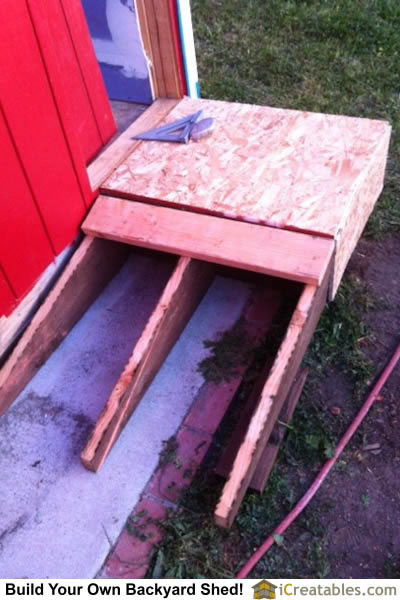 Ramp for doggie entrance into shed.