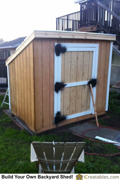 Home built door installed on lean to shed.