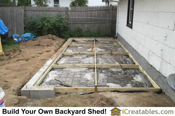 Storage shed floor concrete slab with vapor barrier installed to help concrete cure properly. Wire mesh installed for strength.