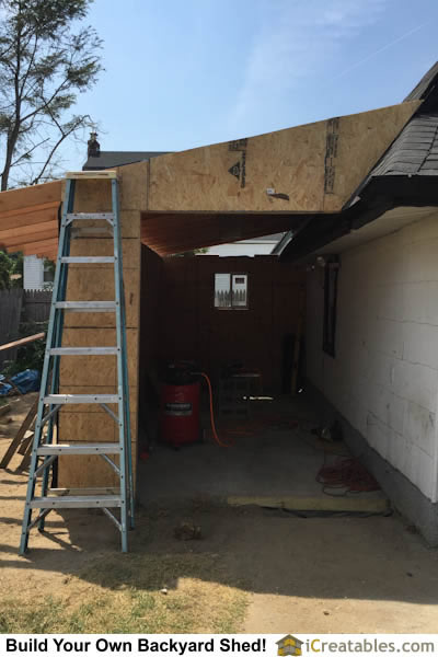 Exterior shed walls sheeted with O.S.B. for strength and to allow the installation of vinyl siding.