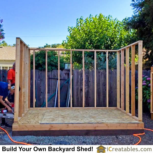 8x10 backyard shed wall framing. The rear and side walls are the same height. The front wall is taller to create the slopped roof.
