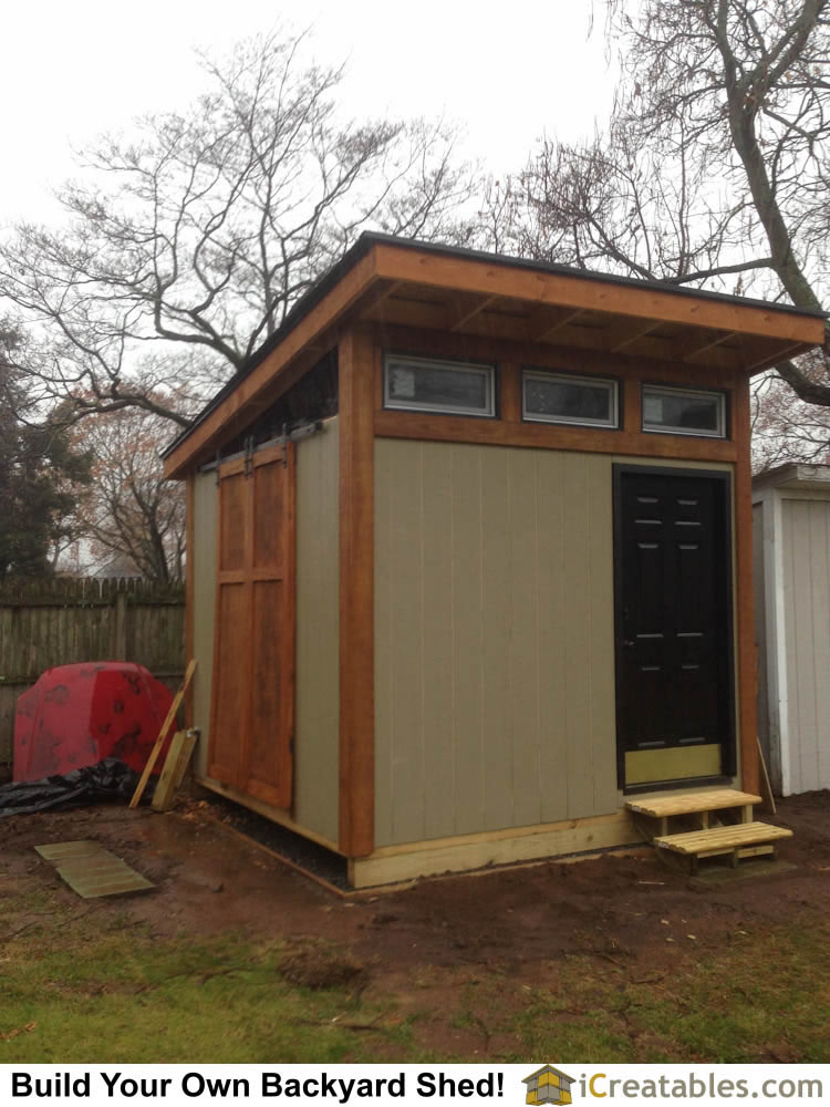 10x10 modern backyard shed. With barn sliding door.