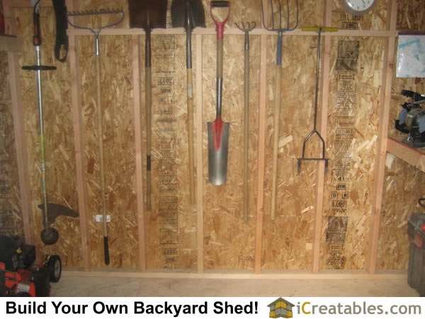 hanging hand yard tools on storage shed walls