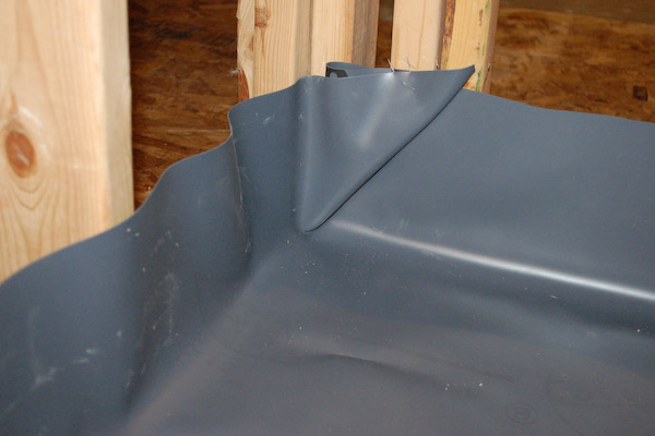 shower pan liner corner fold inside
