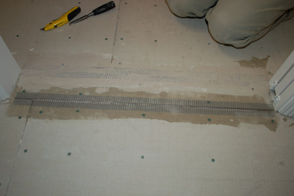Press fiber mesh tape into cement backer board