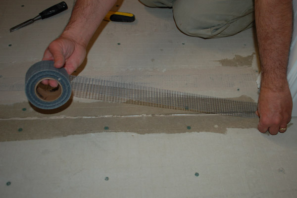 install tape on cement backer board