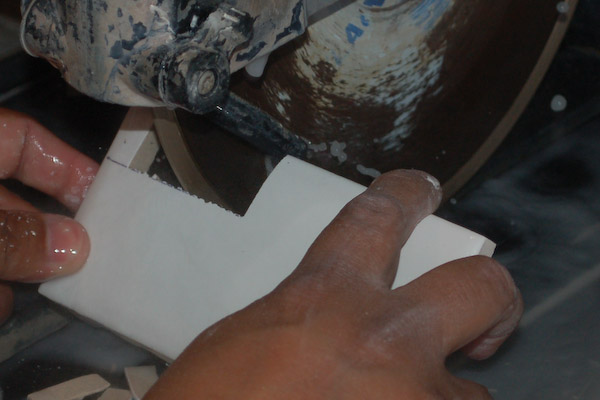 cleaning a tile notch with a tle wet saw